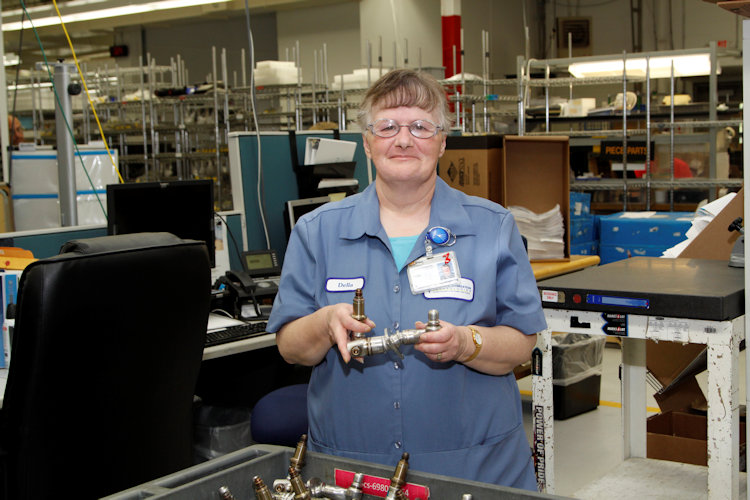 Manufacturing Woman in Blue Shirt